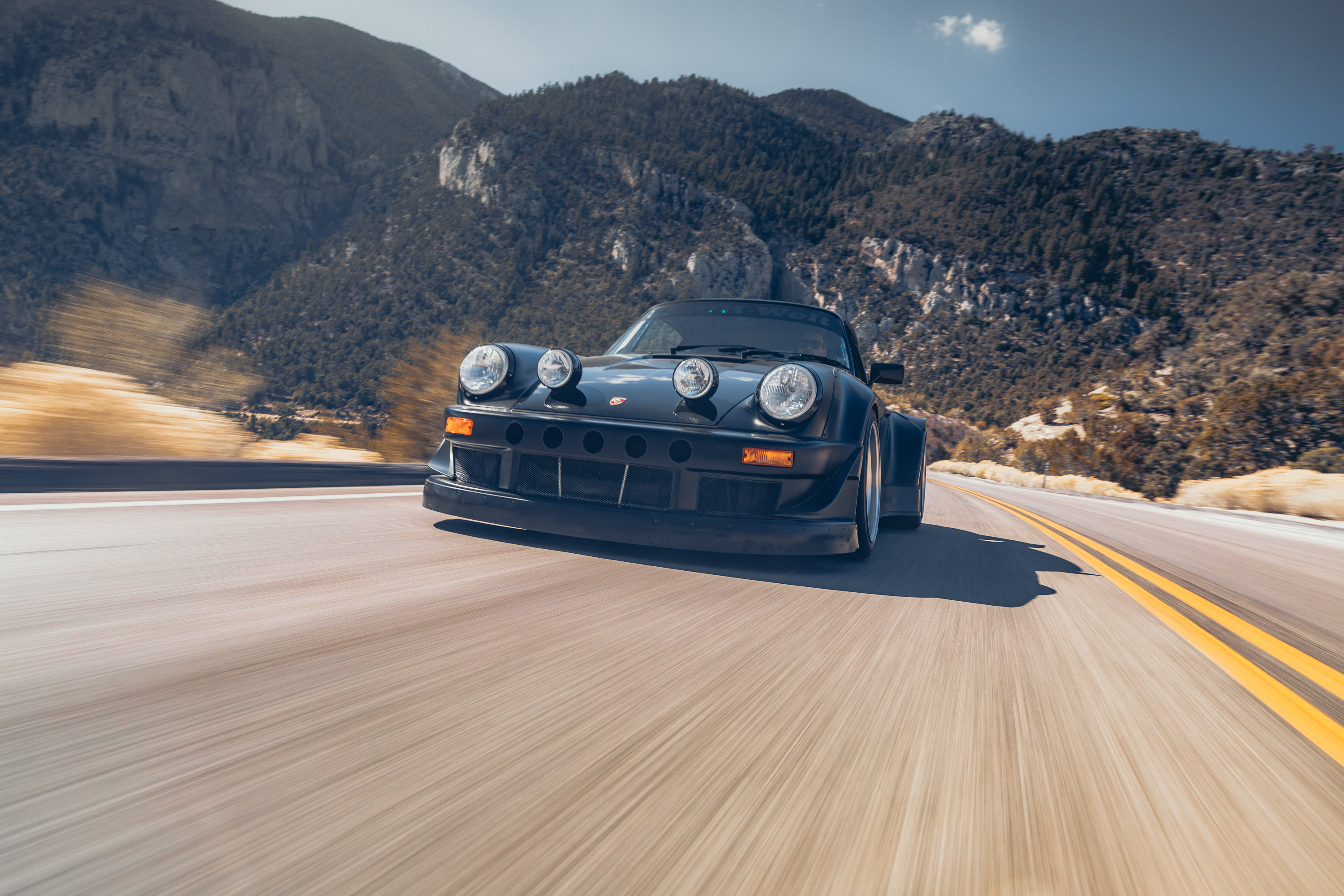 Front end shot of the Need for Speed Porsche 964 in the canyons of Nevada