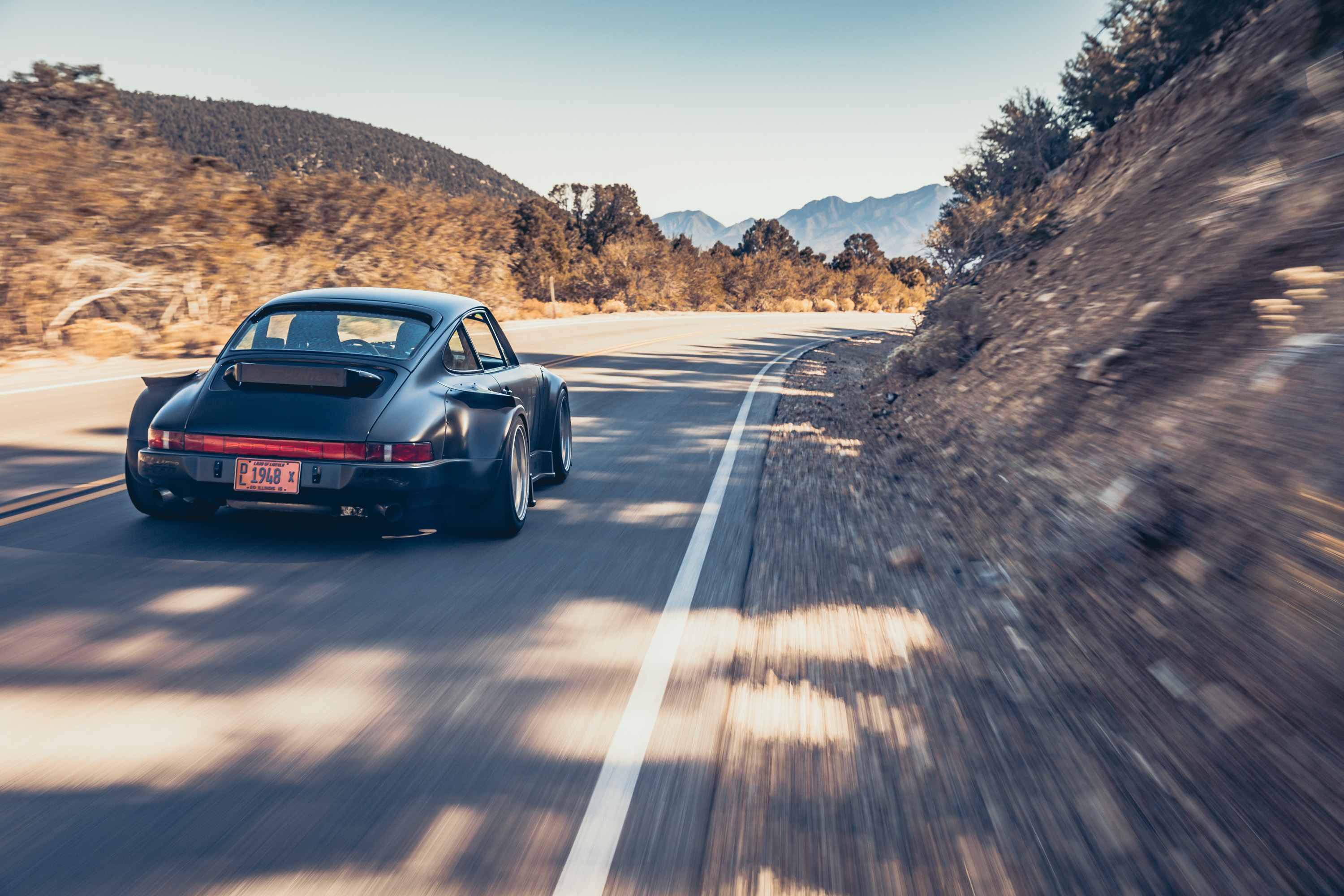 Porsche 964 rolling through Red Rock Canyon after SEMA