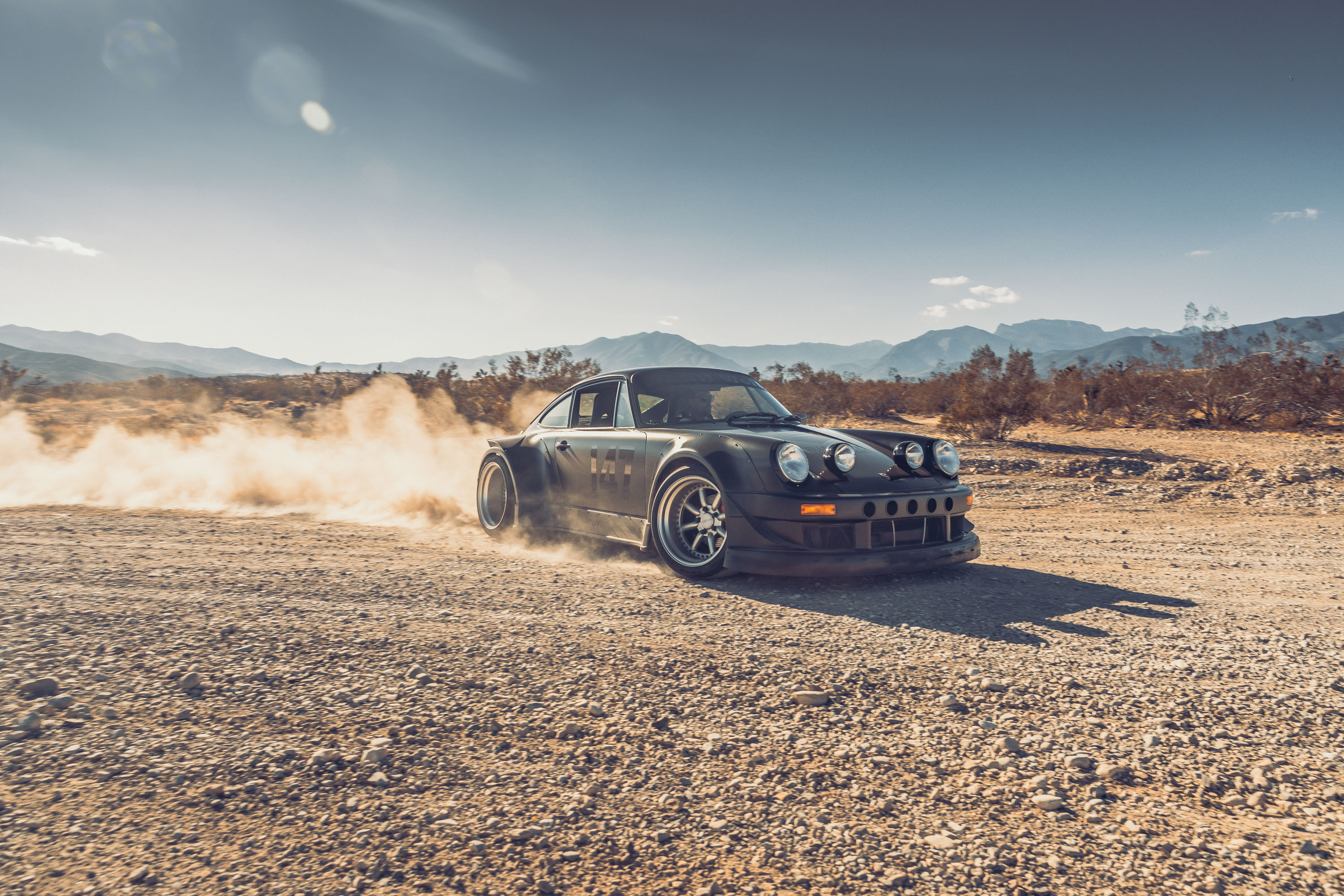 Porsche 964 throwing up dirt in Red Canyon